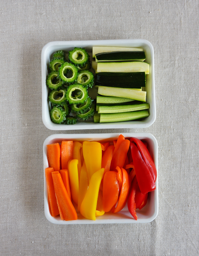 Cut veggies into spears and slices. Salt them for a whole and then drain well.