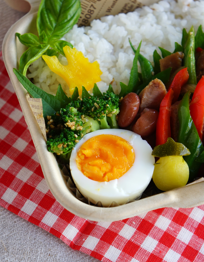 Simmered broccoli with sesame dressing, hard boiled egg, and sweet beans
