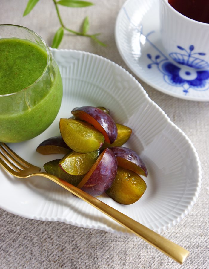 fresh prune fruits, green smoothie and a cup of tea.